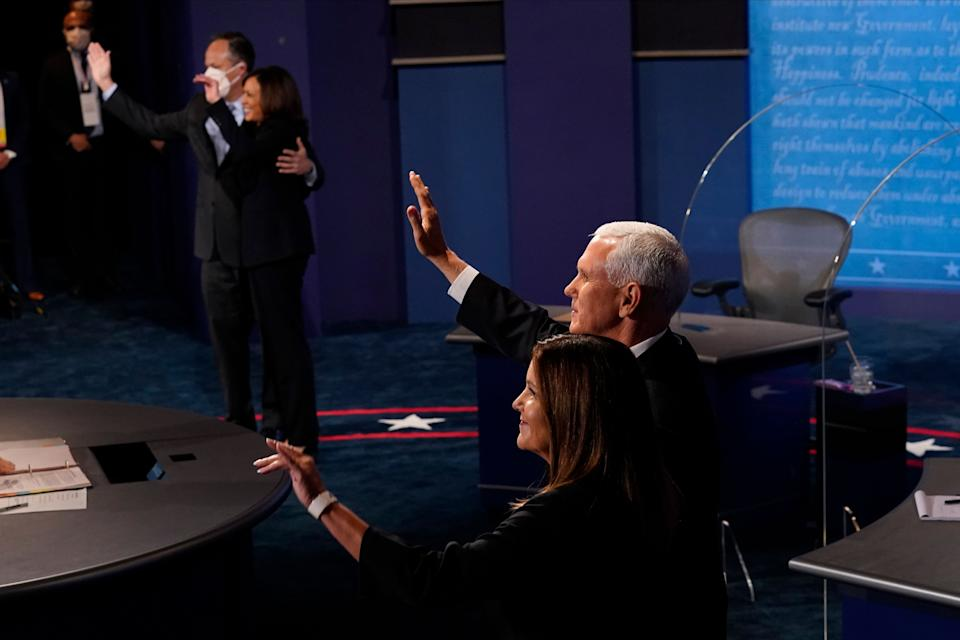 Vice President Mike Pence and his wife Karen Pence with Democratic vice presidential candidate Kamala Harris and her husband Douglas Emhoff wave at the end of the vice presidential debate on October 7, 2020, at Kingsbury Hall on the campus of the University of Utah in Salt Lake City. (Photo by Morry Gash / POOL / AFP) (Photo by MORRY GASH/POOL/AFP via Getty Images)