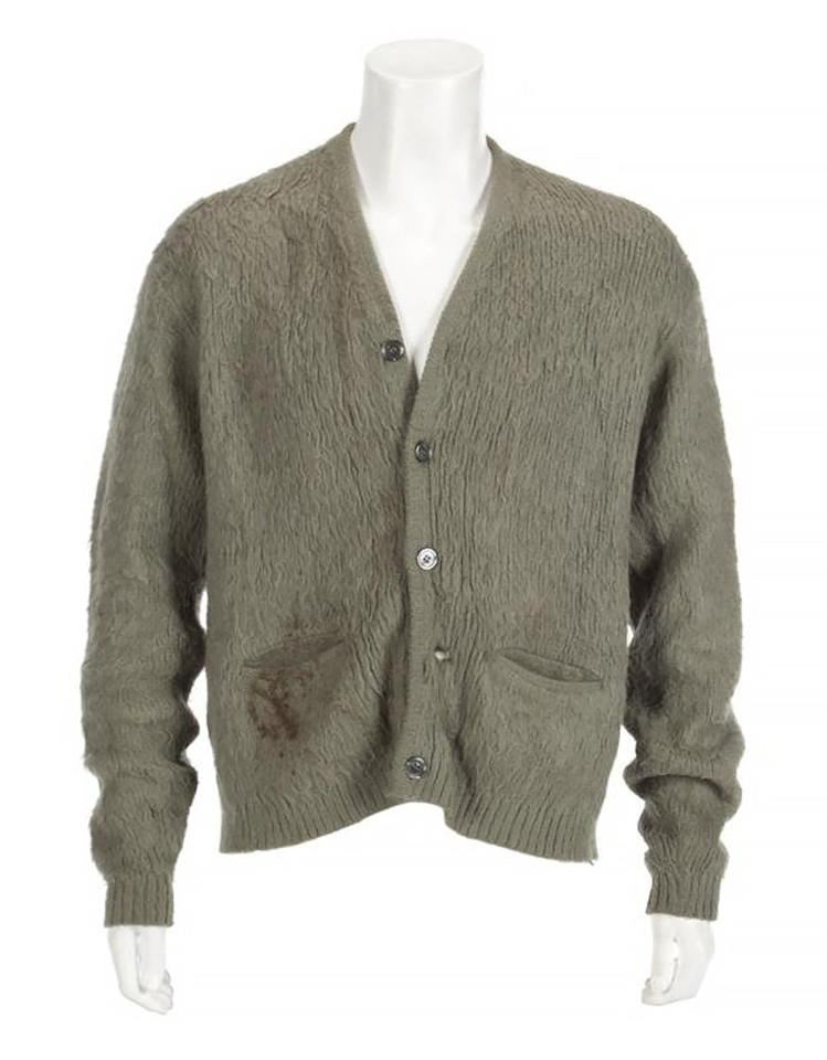 """The olive green sweater Kurt Cobain wore during Nirvana's MTV Unplugged performance in 1993 — which marked one of his last performances before his death on April 5, 1994 at age 27 — <a href=""""https://people.com/style/kurt-cobain-green-cardigan-mtv-unplugged-breaks-record-at-auction/"""">recently sold for a record-breaking $334,000</a>. The sale also included a handwritten note from Jackie Farry, a longtime owner of the sweater and a close Cobain family friend."""