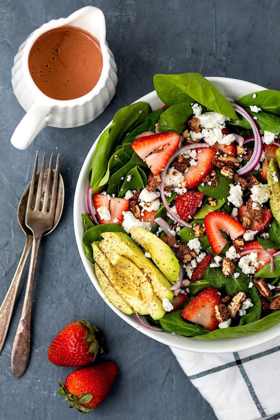 """<p>If a salad recipe is what you're after, there's no contesting the fact that spinach leaves topped with berries and a poppyseed dressing screams summer. </p><p><a href=""""https://www.twopeasandtheirpod.com/strawberry-spinach-salad-with-strawberry-dressing/"""" rel=""""nofollow noopener"""" target=""""_blank"""" data-ylk=""""slk:Get the recipe."""" class=""""link rapid-noclick-resp"""">Get the recipe. </a></p>"""