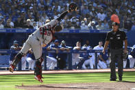 Minnesota Twins catcher Ryan Jeffers misses catching a pop-up fly ball off the bat of Toronto Blue Jays' George Springer in the first inning of a baseball game in Toronto on Saturday, Sept. 18, 2021. (Jon Blacker/The Canadian Press via AP)