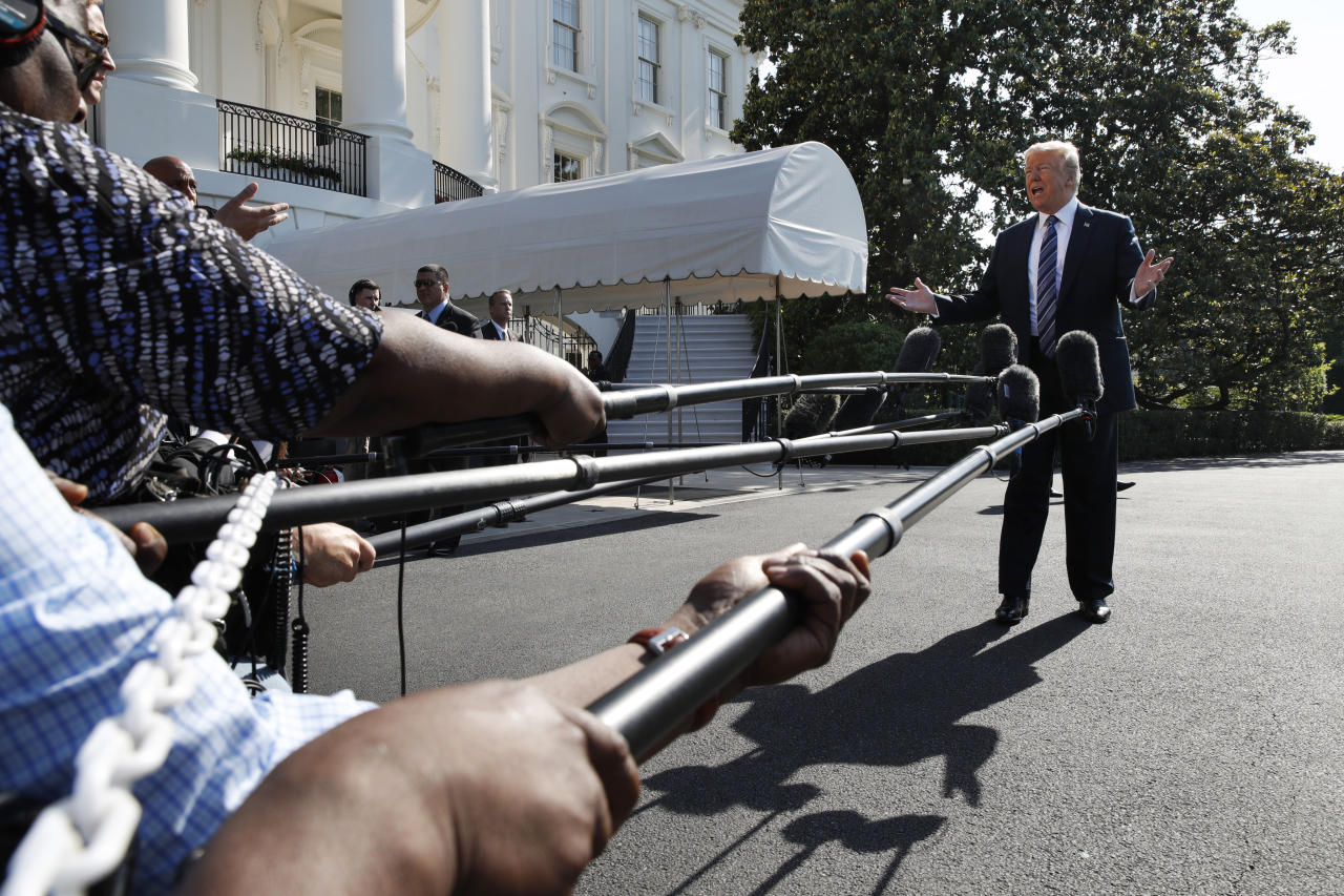<p> President Donald Trump speaks to the media as he walks to the Marine One helicopter Friday, May 25, 2018, on the South Lawn of the White House in Washington. Trump is traveling to Annapolis, Md., to address the U.S. Naval Academy graduation ceremonies. (AP Photo/Jacquelyn Martin) </p>