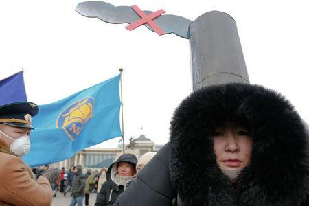 A woman wears a costume as she takes part in an anti-pollution protest in front of a government building in central Ulaanbaatar, Mongolia January 28, 2017. REUTERS/B. Rentsendorj