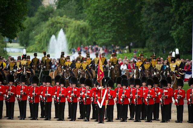LONDON, ENGLAND - JUNE 15: Members of the Queen's Guard and the Household Cavalry during the Trooping Of The Colour at Horse Guards Parade on June 15, 2013 in London, England. Today's ceremony which marks the Queens official birthday will not be attended by Prince Philip the Duke of Edinburgh as he recuperates from abdominal surgery and will also be The Duchess of Cambridge's last public engagement before her baby is due to be born next month. (Photo by Bethany Clarke/Getty Images)