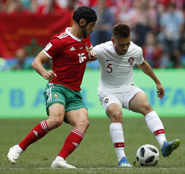 Morocco's Noureddine Amrabat, left, challenges for the ball Portugal's Raphael Guerreiro, right, during the group B match between Portugal and Morocco at the 2018 soccer World Cup in the Luzhniki Stadium in Moscow, Russia, Wednesday, June 20, 2018. (AP Photo/Francisco Seco)