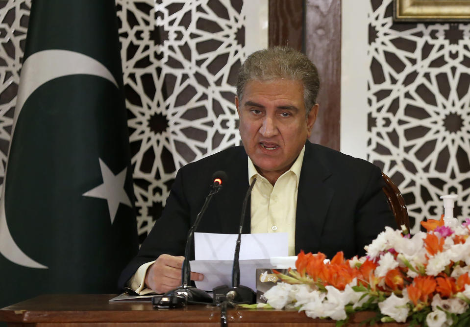 Pakistan's Foreign Minister Shah Mahmood Qureshi briefs to media during a joint press conference with military spokesman regarding on going tension between Pakistan and India, in Islamabad, Pakistan, Saturday, Nov. 14, 2020. Pakistani and Indian troops clashed in disputed Kashmir, causing casualties and wounding more than 30 others on both sides, officials said. The fighting came amid increasing tension between the South Asian neighbors. (AP Photo/Anjum Naveed)