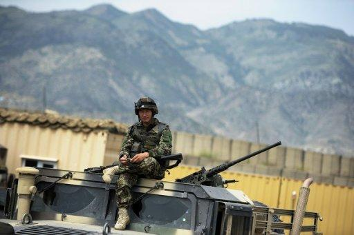 An Afghan soldier, pictured on top of a military vehicle at a base in Khost Province, on August 14, 2012