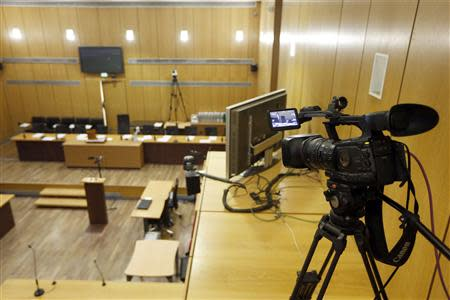 A camera which is set up to record exceptionally for archive the trial of former Rwandan army captain Pascal Simbikangwa is seen in a courtroom before the start of the trial at a Paris court