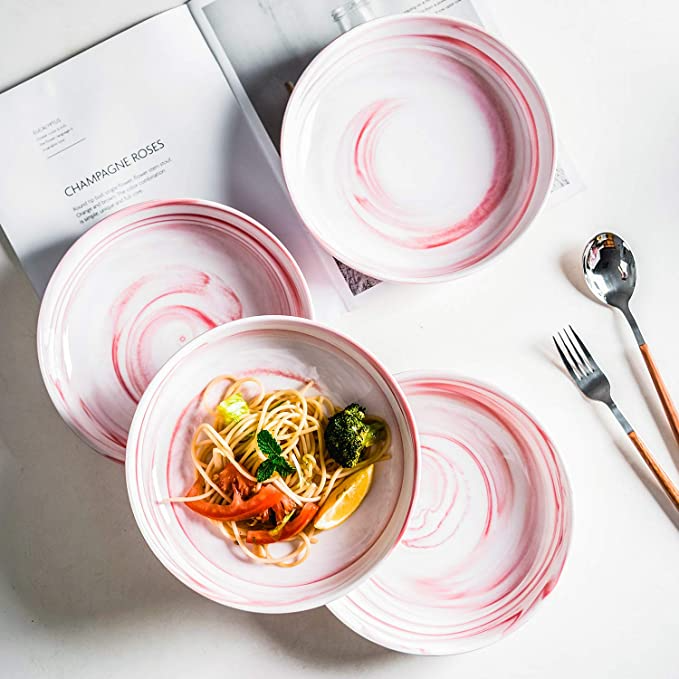 """<h3>Ceramic Marbled Pasta Bowl Set</h3><br>The search for dinnerware with that handmade-look at a budget-price ends here — this set of marbled pasta bowls comes in dreamy faded-pastel options from pink to blue, gray, or green.<br><br><strong>Yundu</strong> Ceramic Pasta Bowl, Set of 2, $, available at <a href=""""https://amzn.to/37SEZku"""" rel=""""nofollow noopener"""" target=""""_blank"""" data-ylk=""""slk:Amazon"""" class=""""link rapid-noclick-resp"""">Amazon</a>"""
