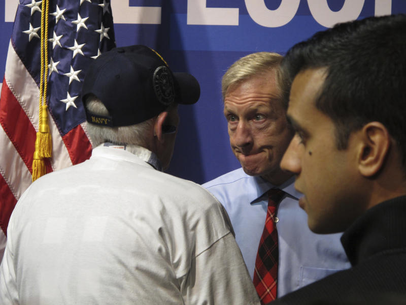 """In this Tuesday, Feb. 11, 2020, photo, Democratic presidential hopeful Tom Steyer listens to a U.S. military veteran after speaking to about 200 people during a town hall gathering at the National Automobile Museum in Reno, Nev. The California billionaire says his campaign is """"doing fine"""" despite dismal showings in Iowa and New Hampshire, but has to do """"very well"""" in the Nevada caucuses next up Feb. 22. (AP Photo/Scott Sonner)"""