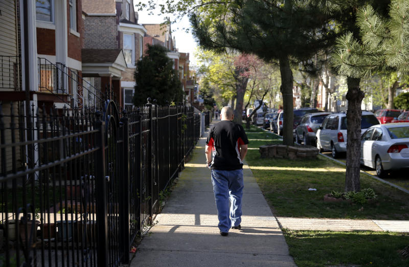 In this photo taken April 20, 2017, Joseph Rodriguez returns to his sister's home in Chicago. The 51-year-old Chicagoan spent 35 years in prison for killing two people in a shooting when he was a teenager. A new poll says nearly 7 in 10 older Americans who spent time in prison are anxious about the amount they have saved for retirement. The survey says they are less likely to have income from Social Security, retirement accounts or a pension and more likely to rely on disability payments. More than half worry that the money they do have for retirement won't last over their lifetime. (AP Photo/Charles Rex Arbogast)