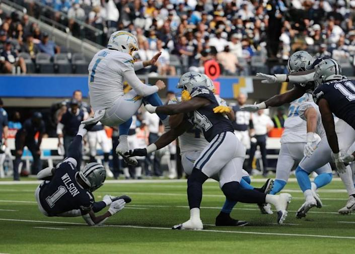 Dallas Cowboys defensive end Azur Kamara is charged with roughing the kicker on Los Angeles Chargers punter Ty Long