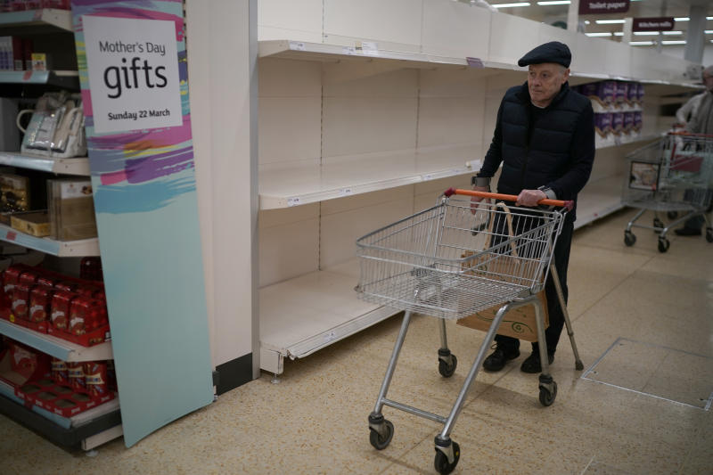 "NORTHWICH, UNITED KINGDOM - MARCH 19: Senior citizens walk past empty shelves as they shop at Sainsbury's Supermarket on March 19, 2020 in Northwich, United Kingdom. A queue of approximately 600 old age pensioners formed before the market opened at 7am as the shop opened specially for the elderly. After spates of ""panic buying"" cleared supermarket shelves of items like toilet paper and cleaning products, stores across the UK have introduced limits on purchases during the COVID-19 pandemic. Some have also created special time slots for the elderly and other shoppers vulnerable to the new coronavirus. (Photo by Christopher Furlong/Getty Images)"