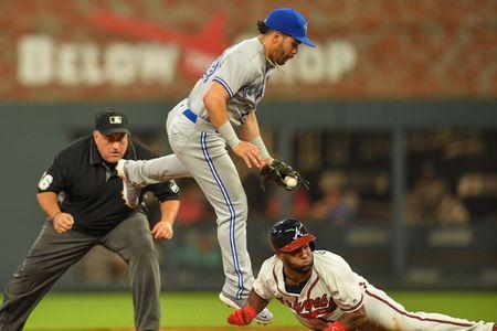 Jul 11, 2018; Atlanta, GA, USA; Toronto Blue Jays second baseman Devon Travis (29) tries to get a tag on Atlanta Braves center fielder Danny Santana (23) eighth inning at SunTrust Park. Mandatory Credit: Dale Zanine-USA TODAY Sports