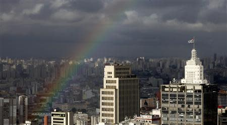 A rainbow appears over the sky of the city of Sao Paulo April 24, 2014. Sao Paulo is one of the host cities for the 2014 soccer World Cup in Brazil. REUTERS/Paulo Whitaker