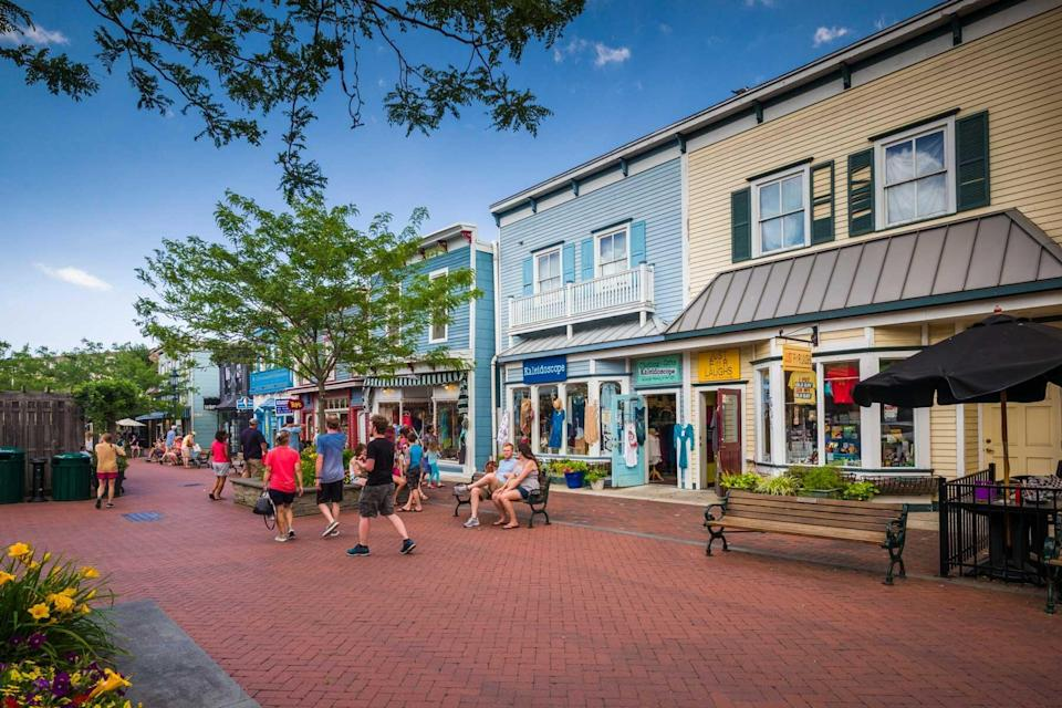 People walking the streets of Cape May, NJ with quaint little beach town shops