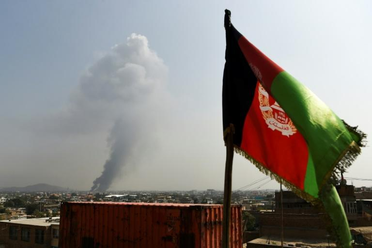 Smoke rises from the site of a massive explosion in Kabul last year