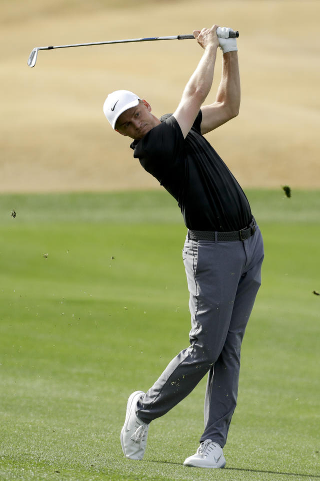 Adam Long hits from the fairway on the second hole during the final round of the Desert Classic golf tournament on the Stadium Course at PGA West on Sunday, Jan. 20, 2019, in La Quinta, Calif. (AP Photo/Chris Carlson)