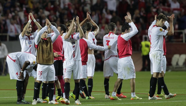Sevilla's players wave at the end of the match against Valencia during their Europa League semifinal first leg soccer match at the Ramon Sanchez Pizjuan stadium, in Seville, Spain on Thursday, April 24, 2014. (AP Photo/Miguel Angel Morenatti)