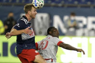 New England Revolution's Henry Kessler, left, heads the ball next to Toronto FC's Ayo Akinola during the first half of an MLS soccer match, Wednesday, Oct. 7, 2020, in Foxborough, Mass. (AP Photo/Steven Senne)