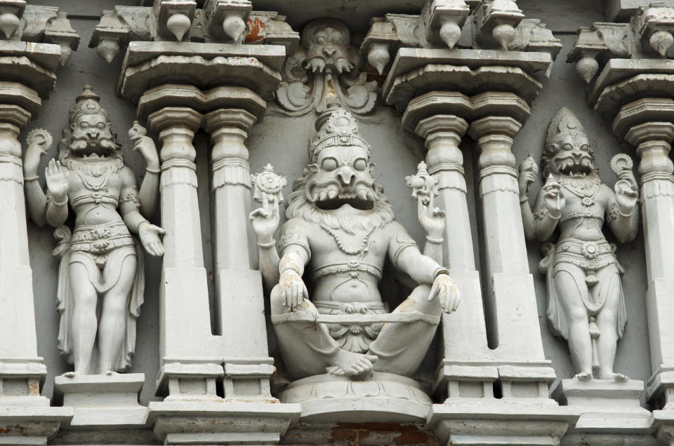 Chennai, Tamil Nadu, India, 29 Sep 2015 : Façade of Parthasarathy Temple. The Parthasarathy Temple  is an 8th-century Hindu temple dedicated to the god Krishna, located at Triplicane, Chennai, India, Asia. Krishna was the charioteer for the Pandava prince Arjuna during the Kurukshetra War in the epic Mahabaratha. Intricate architecture on the facade has fine carvings of Hindu Gods as Rama,Sita,Hanuman,Vishnu