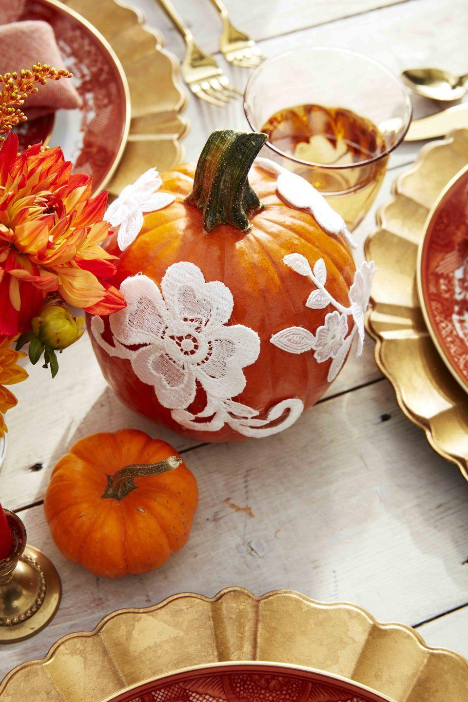 <p>This pretty pumpkin will look right at home on your holiday table or lining a kitchen shelf.<strong><br></strong></p><p><strong>Make the pumpkin:</strong> Separate sections of lace trim or use flower appliqués and attach to pumpkins with hot-glue. </p>