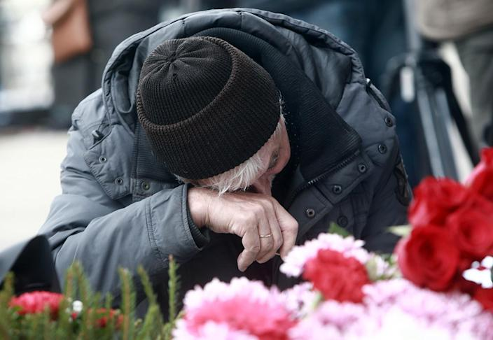 <p>ST PETERSBURG, RUSSIA – APRIL 4, 2017: A woman pays tribute to the St Petersburg Metro explosion victims at Tekhnologichesky Institut station. On April 3, 2017, a blast hit a train carriage in a tunnel between Sennaya Ploschad and Tekhnologichesky Institut stations of the St Petersburg Underground killing at least 14 and injuring 50 people. (Sergei Konkov/TASS via Getty Images) </p>