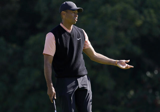 Tiger Woods reacts after missing a putt on the eighth hole during the first round of the Genesis Invitational golf tournament at Riviera Country Club, Thursday, Feb. 13, 2020, in the Pacific Palisades area of Los Angeles. (AP Photo/Ryan Kang)