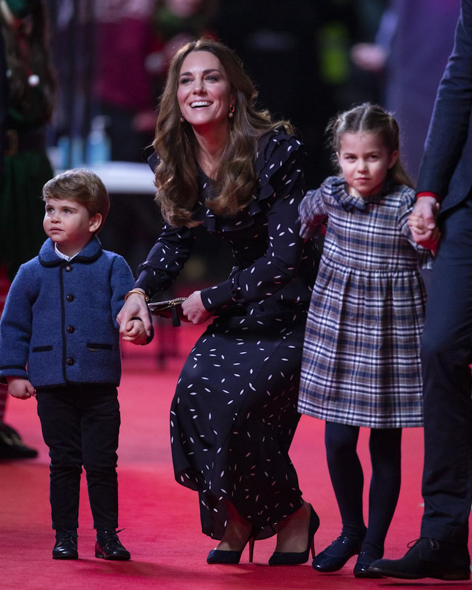 Prince Louis, the Duchess of Cambridge and Princess Charlotte attend a special pantomime performance at London's Palladium Theatre, hosted by The National Lottery, to thank key workers and their families for their efforts throughout the pandemic.