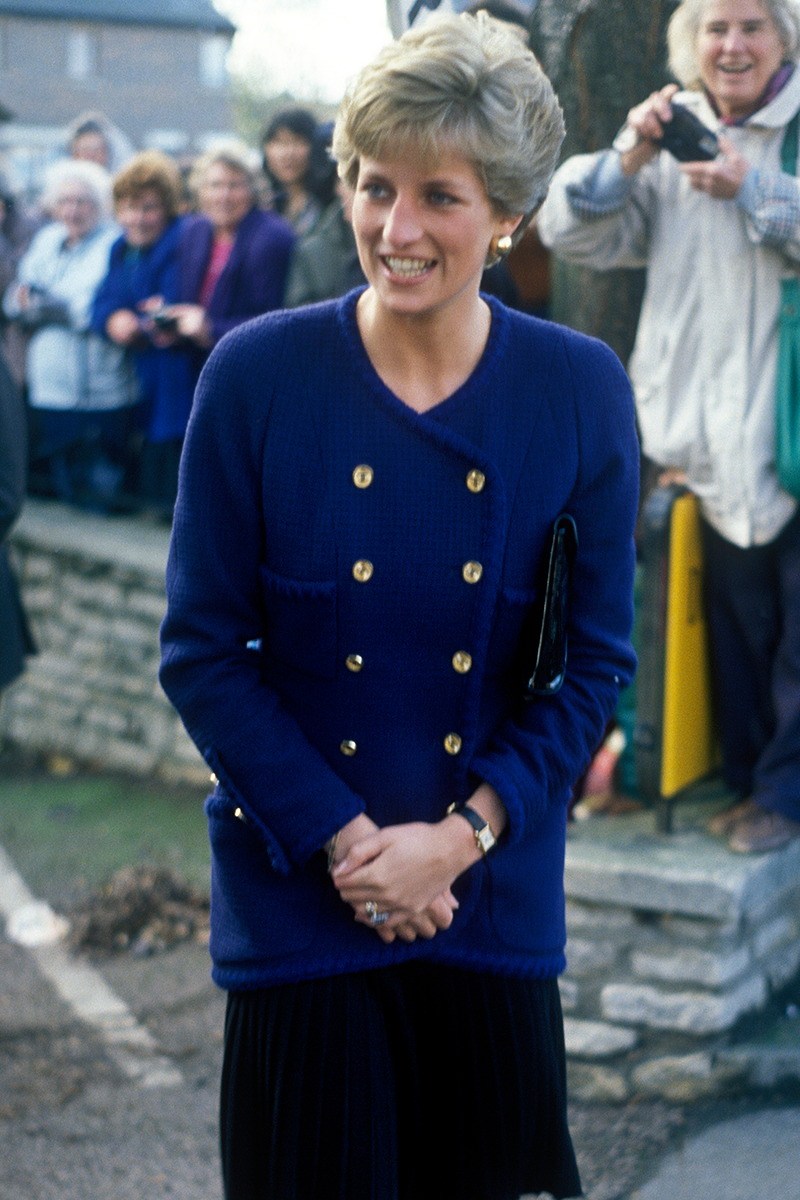 <p>Check out how Diana elevates something as simple as a cardigan with some tastefully positioned, military-inspired gold buttons on a trip to Oxford in November 1990. </p>