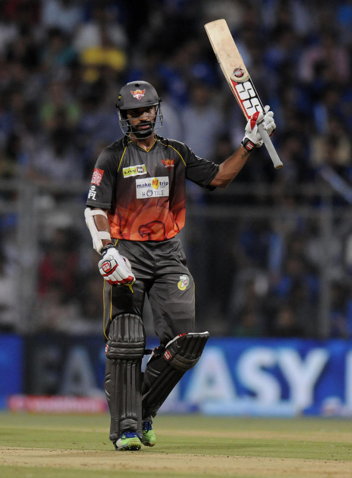 Shikhar Dhawan of Sunrisers Hyderabad raises his bat after scoring a half century during match 62 of the Pepsi Indian Premier League ( IPL) 2013  between The Mumbai Indians and the Sunrisers Hyderabad held at the Wankhede Stadium in Mumbai on the 13th May 2013 ..Photo by Pal Pillai-IPL-SPORTZPICS ..Use of this image is subject to the terms and conditions as outlined by the BCCI. These terms can be found by following this link:..https://ec.yimg.com/ec?url=http%3a%2f%2fwww.sportzpics.co.za%2fimage%2fI0000SoRagM2cIEc&t=1493591292&sig=EROx12RlIHnBn6HrBl4gIw--~C
