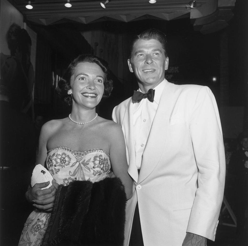 <p>Ronald Reagan and his wife Nancy stand together at the premiere of <em>A Streetcar Named Desire</em> in 1951.</p>