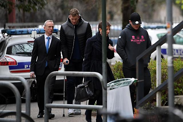 Grenoble's Irish centre Chris Farrell (2ndL) and Grenoble's Irish prop Denis Coulson (R) arrive on March 21, 2017 at the police station in Grenoble, French Alps.Six Grenoble rugby players including two Irishmen, two New Zealanders and an Australian, were detained on March 21, 2017 following a rape complaint, prosecutors said. (AFP Photo/JEAN-PIERRE CLATOT)