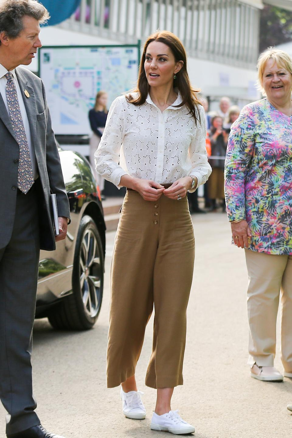 At the RHS Chelsea Flower Show in May 2019 the duchess accessorised her stylish look with the Siren Wire earrings once more.  (Getty Images)