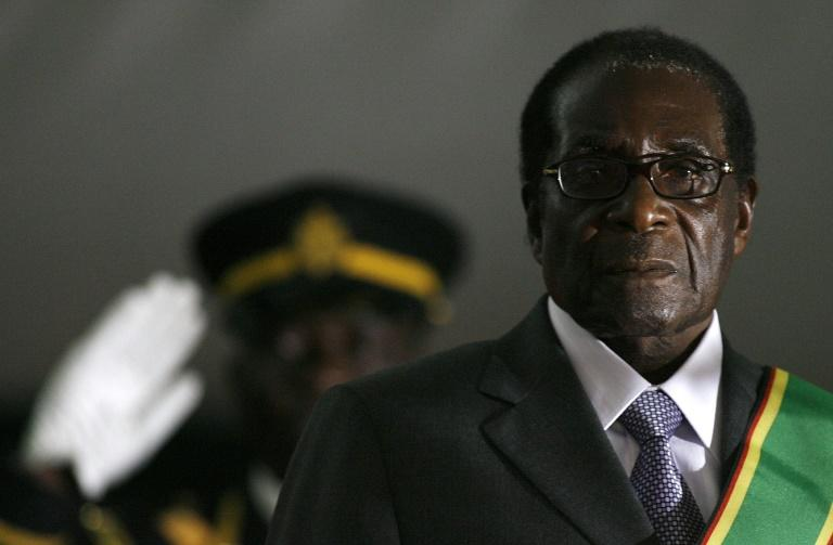 Mugabe turned to repression and fear to crush dissidents and rule for nearly four decades during which he become an international pariah for his takeover of white-owned farms (AFP Photo/ALEXANDER JOE)