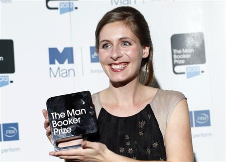 New Zealand writer Catton, winner of the Man Booker Prize 2013, poses for photographs at the Guildhall in central London