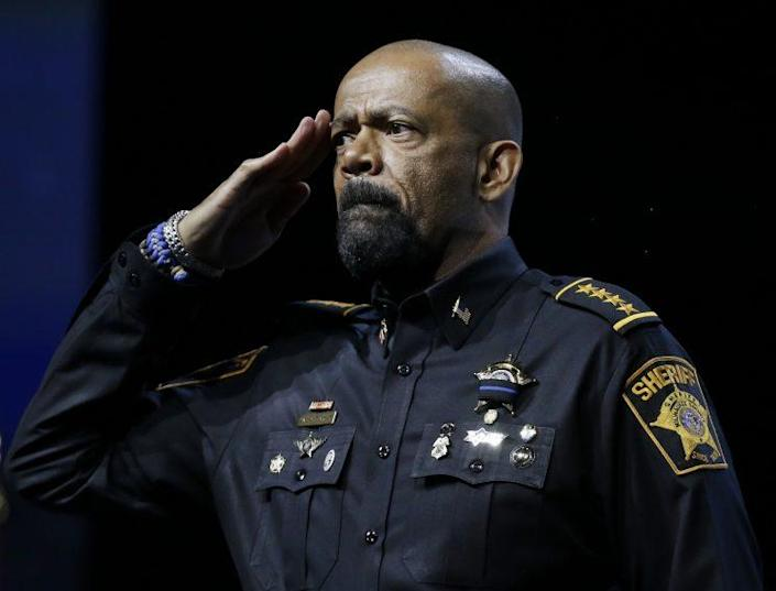 Sheriff David Clarke of Milwaukee County, Wis., salutes the audience before a speech at the National Rifle Association convention in May. (Photo: Mark Humphrey/AP)