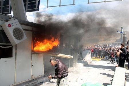 Protesters set toll booths on fire on the Durres-Kukes highway in Kalimash near Kukes, Albania March 31, 2018. REUTERS/Stringer