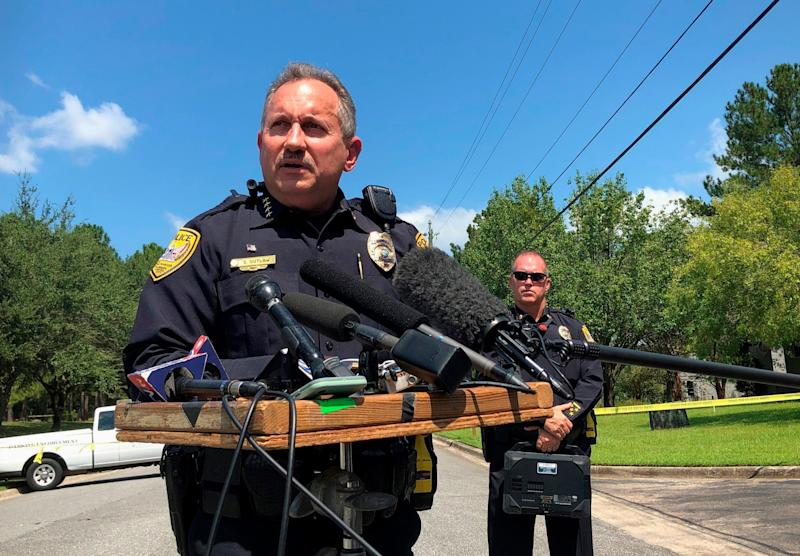 Steven Outlaw, acting police chief in Tallahassee, Florida, briefs reporters over the stabbing of five people at a building supply company: AP