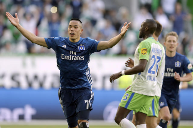 FILE - In this Saturday, April 28, 2018 file photo, Hamburg's Bobby Wood celebrates after scoring during their German Bundesliga soccer match against VfL Wolfsburg in Wolfsburg, Germany. United States striker Bobby Wood has moved to Bundesliga side Hannover from relegated Hamburger SV. Hannover says on Monday, July 9 the 25-year-old Wood is joining on loan for one year, with the option to then make the switch permanent. (AP Photo/Michael Sohn, file)