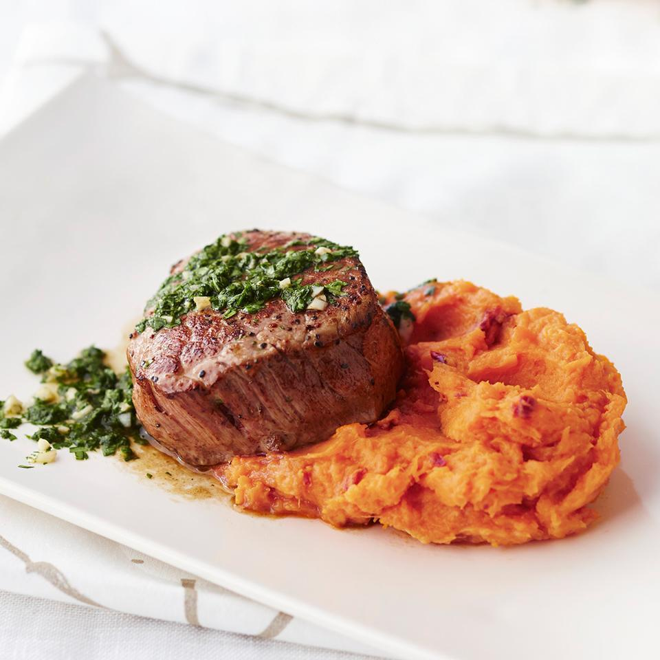 <p>Perfect beef tenderloin filets are served with chipotle-infused sweet potatoes and topped with a cilantro dressing in this special meal for two.</p>