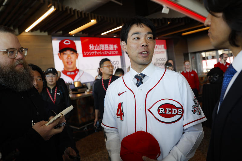 Cincinnati Reds outfielder Shogo Akiyama speaks through an interpreter as he is interviewed after a news conference, Wednesday, Jan. 8, 2020, in Cincinnati. Outfielder Shogo Akiyama agreed to a $21 million, three-year deal with the Cincinnati Reds, the only major league team that hasn't had a player born in Japan. The 31-year-old center fielder was a five-time All-Star during his nine seasons with the Seibu Lions in Japan's Pacific League. (AP Photo/John Minchillo)