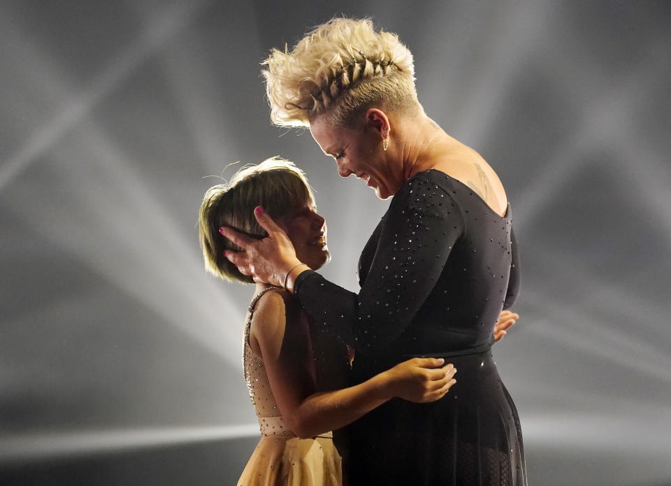 Icon award recipient Pink embraces her daughter Willow after they perform together at the Billboard Music Awards, Friday, May 21, 2021, at the Microsoft Theater in Los Angeles. The awards show airs on May 23 with both live and prerecorded segments. (AP Photo/Chris Pizzello)