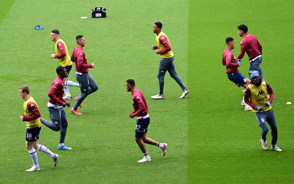 Players warm up for Palace vs Villa - Getty