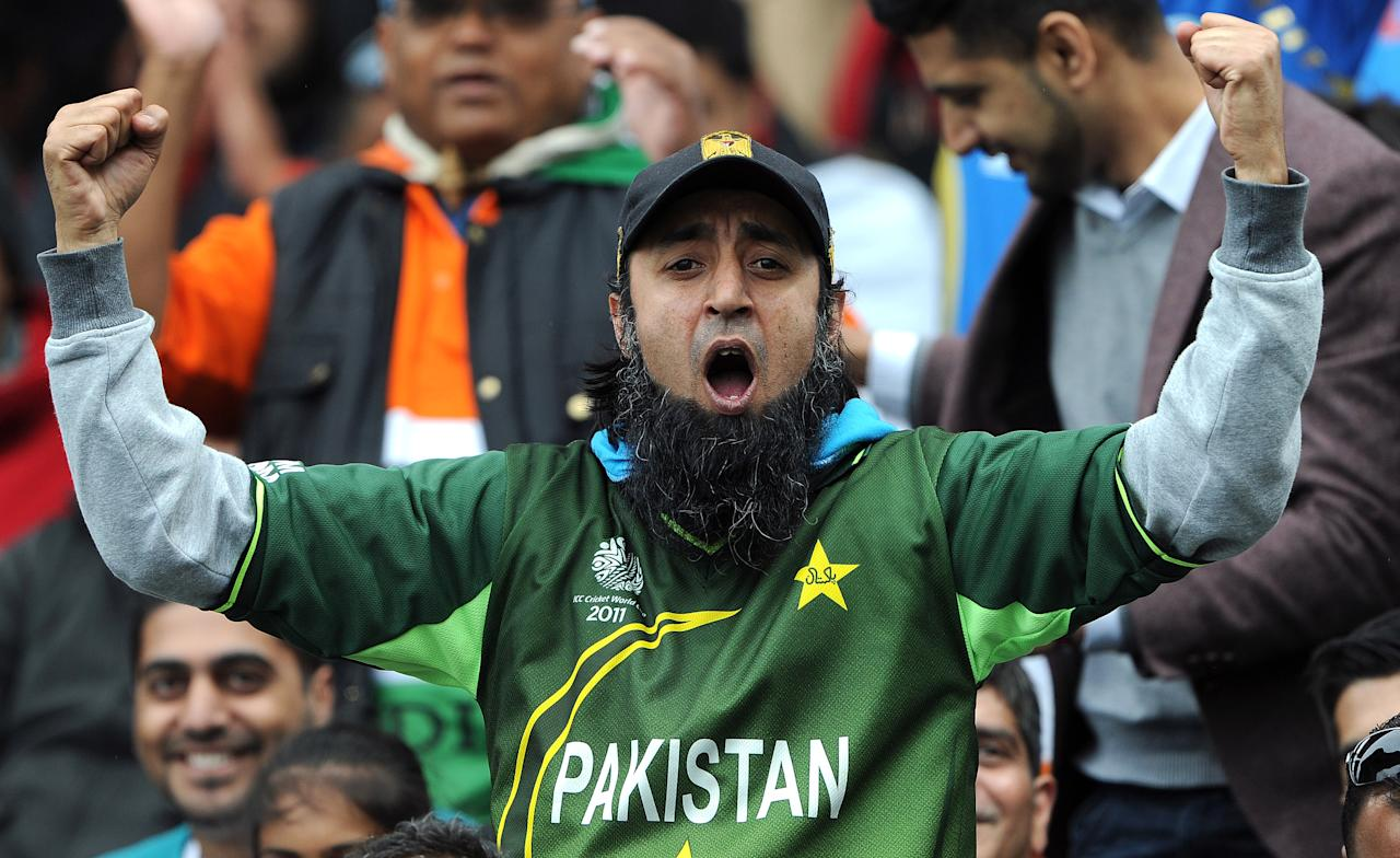 A Pakistani fan cheers during the 2013 ICC Champions Trophy cricket match between Pakistan and India at Edgbaston in Birmingham, central England, on June 15, 2013. (ANDREW YATES/AFP/Getty Images)