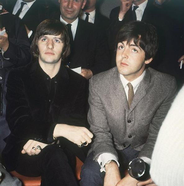 FILE - In this 1965 file photo, two of the Beatles, Ringo Starr, left, and Paul McCartney, appear at a news conference after the announcement that the Honours Award of the M.B.E was awarded to them, in London. McCartney turned 70 years of age Monday June 18, 2012. (AP Photo)