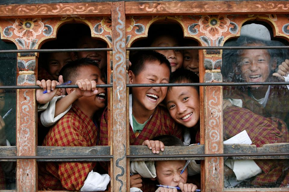 Schoolchildren react to the camera through the window of their classroom in a school in Thimphu, Bhutan, in 2010. Credit: Reuters (Photo: )