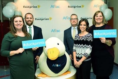 Duckprints Awards honorees, the Greene Family and Aflac agent Susan Svarda, celebrate today's Duckprints event at Dayton Children's Hospital. The Greene family lost their child Emily to cancer. Pictured left to right: Casey Slater, Beau Slater, John Greene, Susan Svarda, Darlene Greene