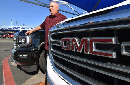 Carey ÒCWÓ Williams, general manager of James Wood MotorsÕ General Motors Company (GMC) shows off new high-end GMC Denali pickup trucks out on his lot in Decatur, Texas, U.S., February 4, 2019. REUTERS/Nick Carey
