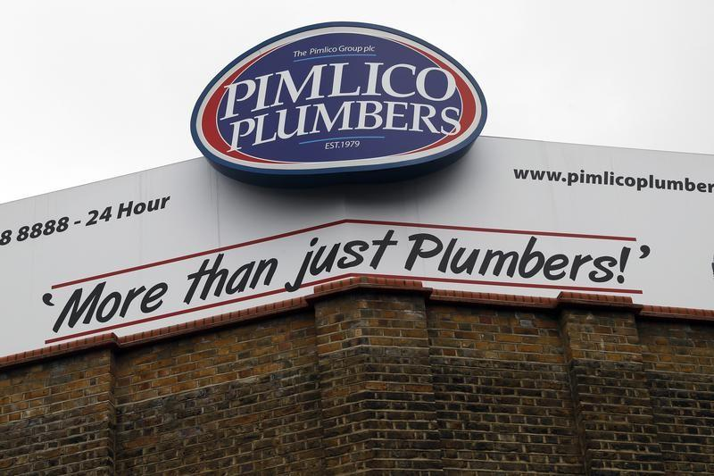 A Pimlico Plumbers sign is seen in London