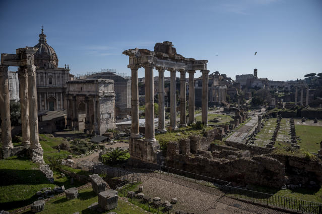 A picture shows the ancient Roman Forum ruins and the Colosseum without people during the coronavirus emergency on March 10, 2020, in Rome, Italy. (Credit: Antonio Masiello/Getty Images)